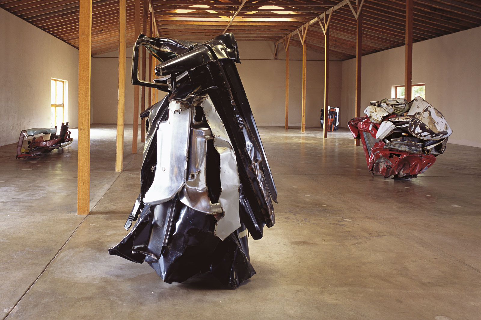 John Chamberlain, 22 variously titled works in painted and chromium-plated steel (detail), 1972-1982.