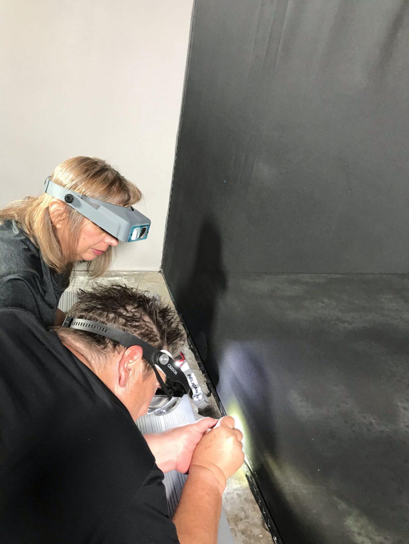 Bettina Landgrebe removes staples from the Irwin scrim