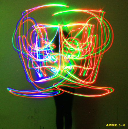 Light drawing recorded through a long exposure.