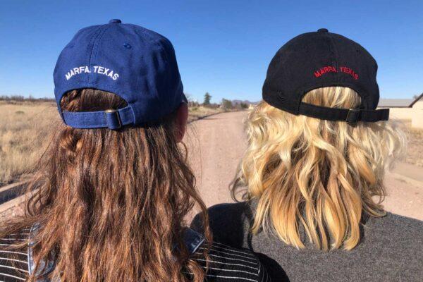 Two girls wearing Chinati caps