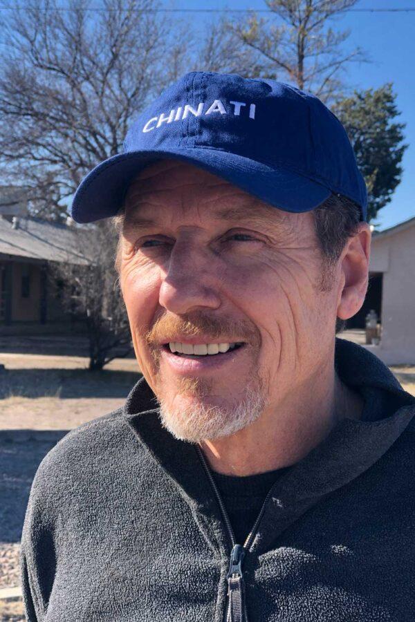 A man in a blue Chinati hat