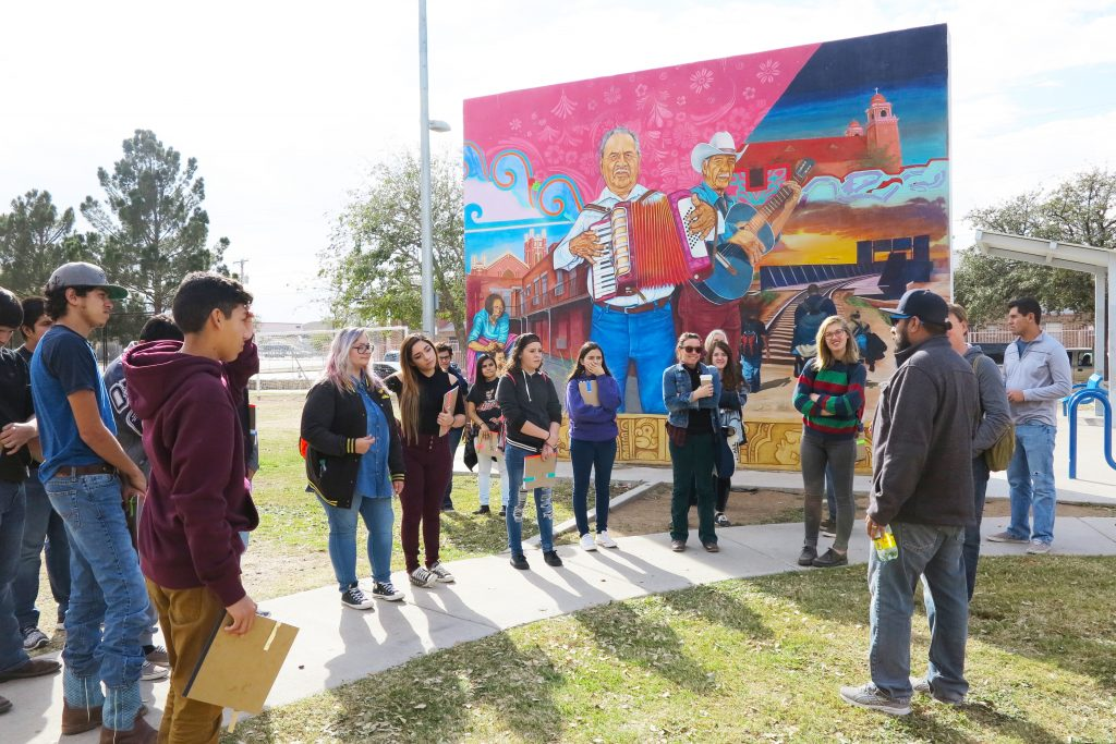 Marfa students visiting with muralist Cimi Alvarado in El Paso.