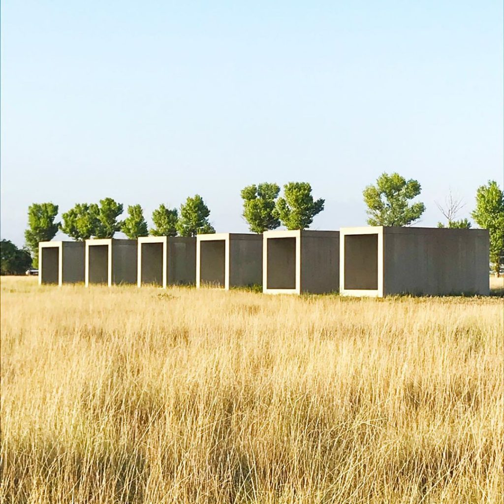 Cottonwoods and Donald Judd's untitled works in concrete .