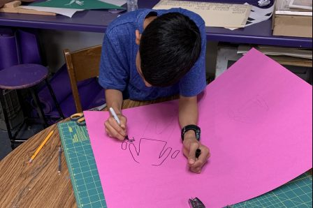 Student drawing puppet for Marfa Myths