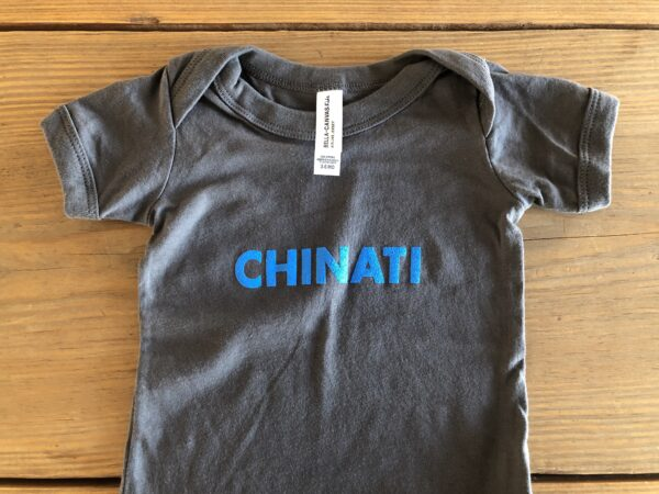 Chinati onesie in asphalt grey with bright blue lettering