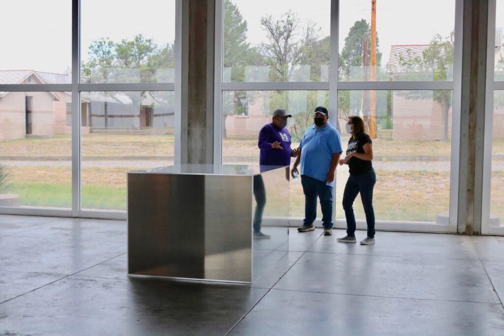 Marfa ISD teachers view Donald Judd's 100 untitled works in mill aluminum.